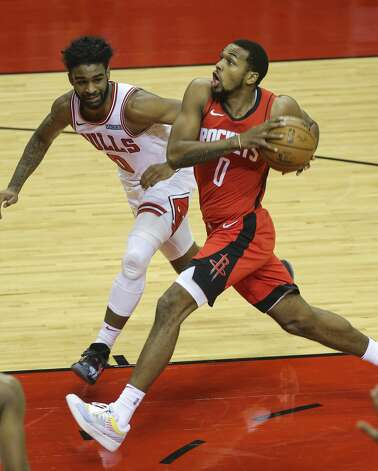 Houston Rockets guard Sterling Brown (0) goes for a lay up while Chicago Bulls guard Coby White (0) is defensing during the first quarter of a NBA game Monday, Feb. 22, 2021, at Toyota Center in Houston. Photo: Yi-Chin Lee/Staff Photographer / © 2021 Houston Chronicle