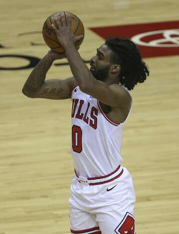 Chicago Bulls guard Coby White (0) aims for the basket during the fourth quarter of a NBA game against the Houston Rockets Monday, Feb. 22, 2021, at Toyota Center in Houston. Houston Rockets lost to Chicago Bulls 120-100. Photo: Yi-Chin Lee/Staff Photographer / © 2021 Houston Chronicle