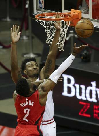 Houston Rockets guard David Nwaba (2) goes for the basket while Chicago Bulls center Wendell Carter Jr. (34) is trying to stop him during the fourth quarter of a NBA game Monday, Feb. 22, 2021, at Toyota Center in Houston. Houston Rockets lost to Chicago Bulls 120-100. Photo: Yi-Chin Lee/Staff Photographer / © 2021 Houston Chronicle