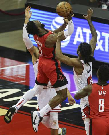 Houston Rockets guard David Nwaba (2) goes for the basket between Chicago Bulls players Denzel Valentine (45) and Coby White (0) during the fourth quarter of a NBA game Monday, Feb. 22, 2021, at Toyota Center in Houston. Houston Rockets lost to Chicago Bulls 120-100. Photo: Yi-Chin Lee/Staff Photographer / © 2021 Houston Chronicle