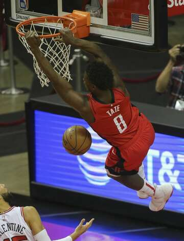 Houston Rockets forward Jae'Sean Tate (8) hangs onto the ring after dunking the ball during the fourth quarter of a NBA game against the Chicago Bulls Monday, Feb. 22, 2021, at Toyota Center in Houston. Houston Rockets lost to Chicago Bulls 120-100. Photo: Yi-Chin Lee/Staff Photographer / © 2021 Houston Chronicle