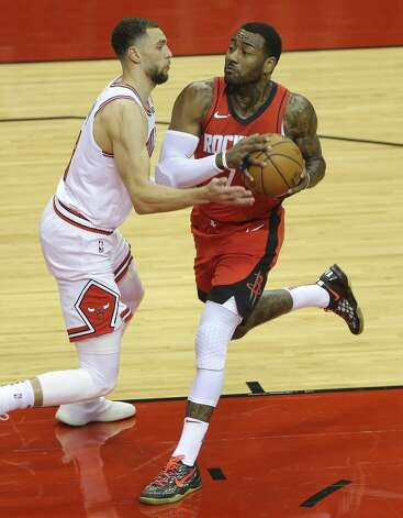 Houston Rockets guard John Wall (1) goes toward the basket while Chicago Bulls guard Zach LaVine (8) is defensing during the first quarter of a NBA game Monday, Feb. 22, 2021, at Toyota Center in Houston. Photo: Yi-Chin Lee/Staff Photographer / © 2021 Houston Chronicle