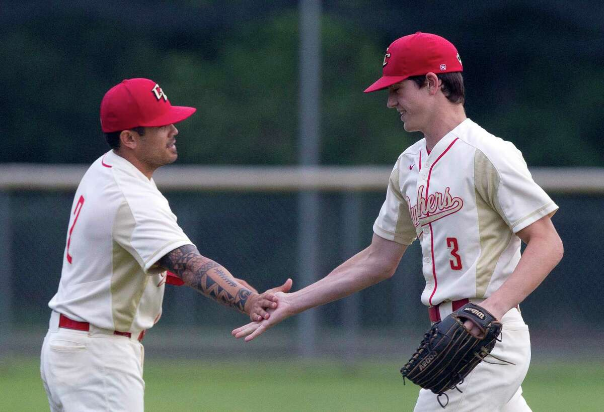 FILE - Caney Creek right fielder Derek Brieden (3) gets a high-five after fielding a fly ball by Andrew Carter #4 of Montgomery during the second inning of a District 20-5A high school baseball game at Caney Creek High School, Tuesday, April 23, 2019, in Grangerland.