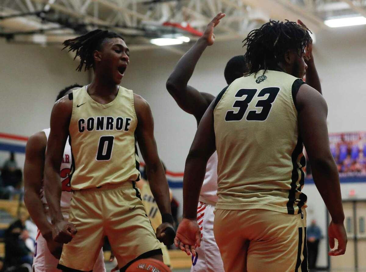 FILE - Conroe's Ja'Len Moore (0) reacts after Kamari Weatherspoon (33) draws a foul during the third quarter of a District 13-6A high school basketball game at Oak Ridge High School, Friday, Feb. 12, 2021.