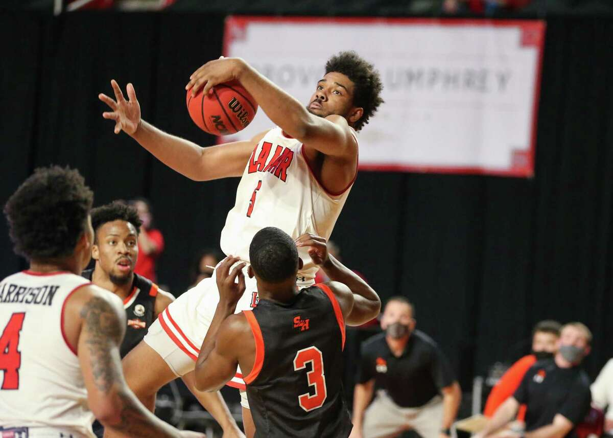 Lamar senior forward Avery Sullivan grabs a rebound during the Cardinals' loss to Sam Houston Monday night at the Montagne Center.
