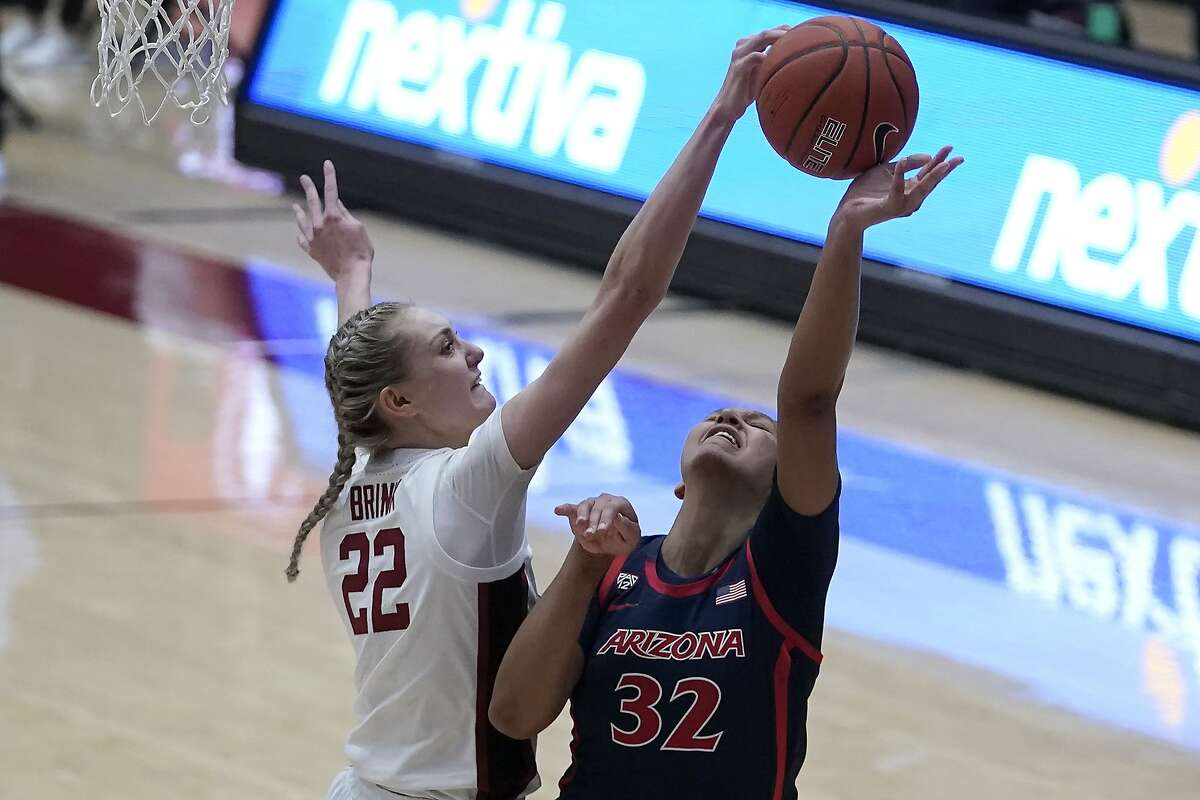Stanford forward Cameron Brink (22) blocks a shot by Arizona forward Lauren Ware (32) during the second half of an NCAA college basketball game in Stanford, Calif., Monday, Feb. 22, 2021.