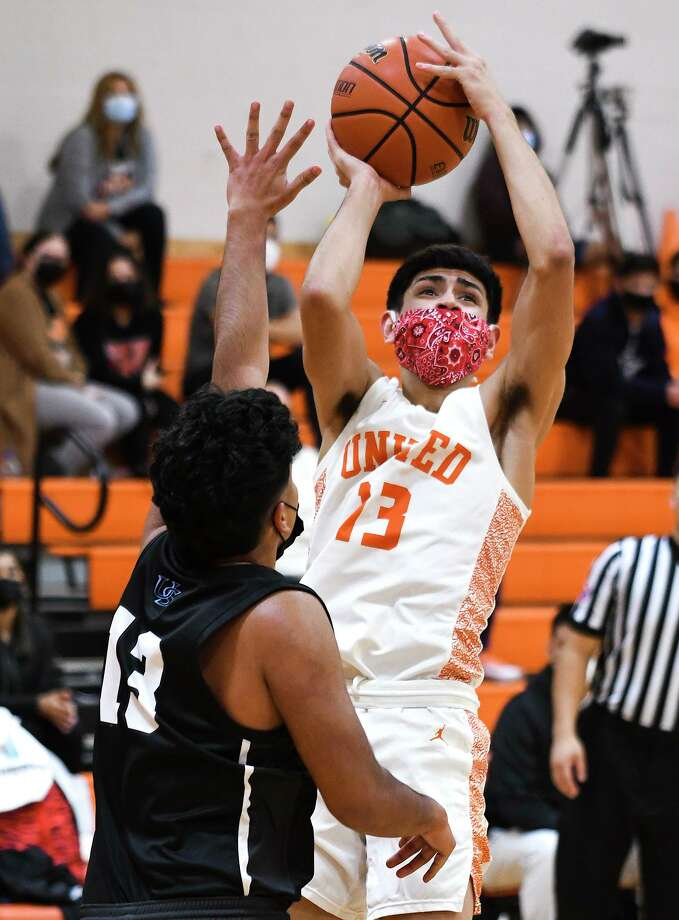 Carlos Puerto scored 13 points as United beat San Antonio Brennan 55-51 to advance in the state playoffs. Photo: Danny Zaragoza /Laredo Morning Times File