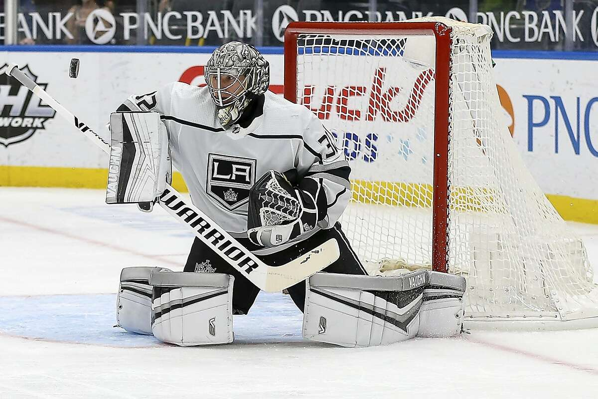 Los Angeles Kings' goaltender Jonathan Quick (32) deflects the puck during the second period of an NHL hockey game against the St. Louis Blues, Monday Feb. 22, 2021, in St. Louis. (AP Photo/Scott Kane)