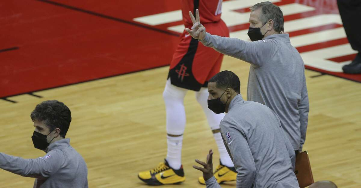 Houston Rockets coaches signals the referees that they will forfeit the last few seconds of the fourth quarter of a NBA game against the Chicago Bulls Monday, Feb. 22, 2021, at Toyota Center in Houston. Houston Rockets lost to Chicago Bulls 120-100.