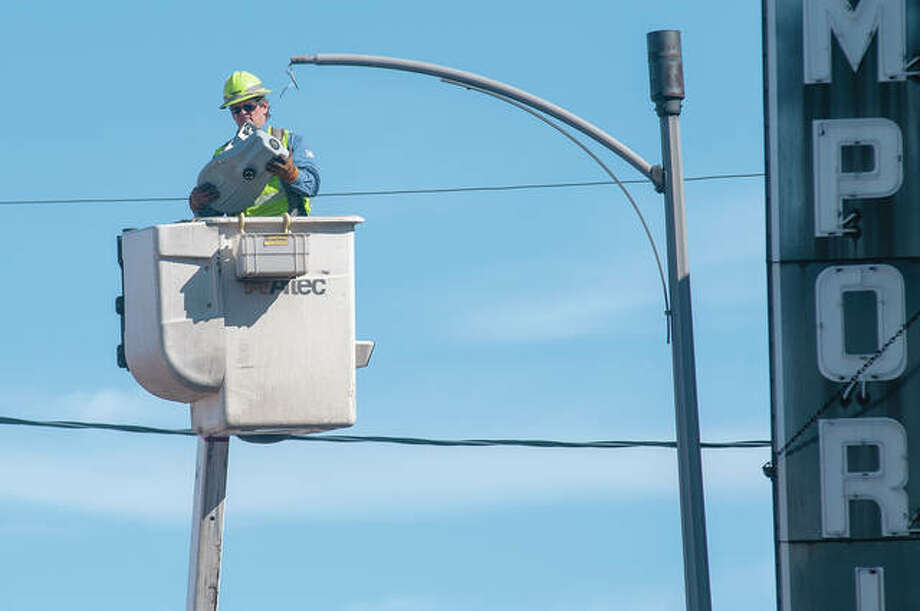 Ameren employee Jeff Elliott replaces a street light Monday on Court Street after learning that several of them were out. Elliott said he replaced it with a brighter one to ensure the street is well illuminated. Photo: Darren Iozia | Journal-Courier