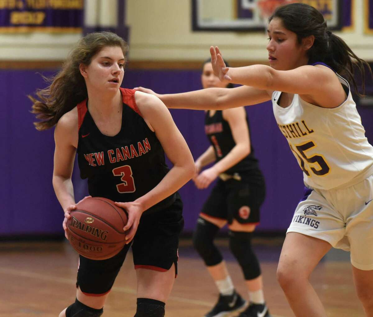 New Canaan's Natalie Plosker (3) looks to pass as Westhill's Jane Bautista (15) defends during a girls basketball game at Westhill High School in Stamford on Monday, Feb. 17, 2020.