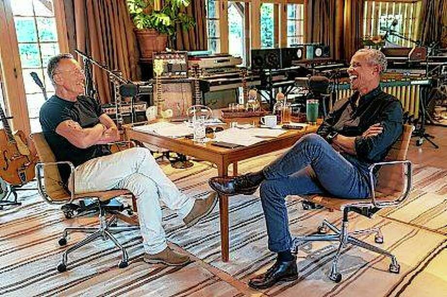Bruce Springsteen (left) appears with former President Barack Obama during their podcast of conversations recorded at Springsteen's home studio in New Jersey. The eight-episode series covers their upbringings, racism, fatherhood and even recall a White House singalong around a piano. Photo: Rob DeMartin | Spotify Via AP