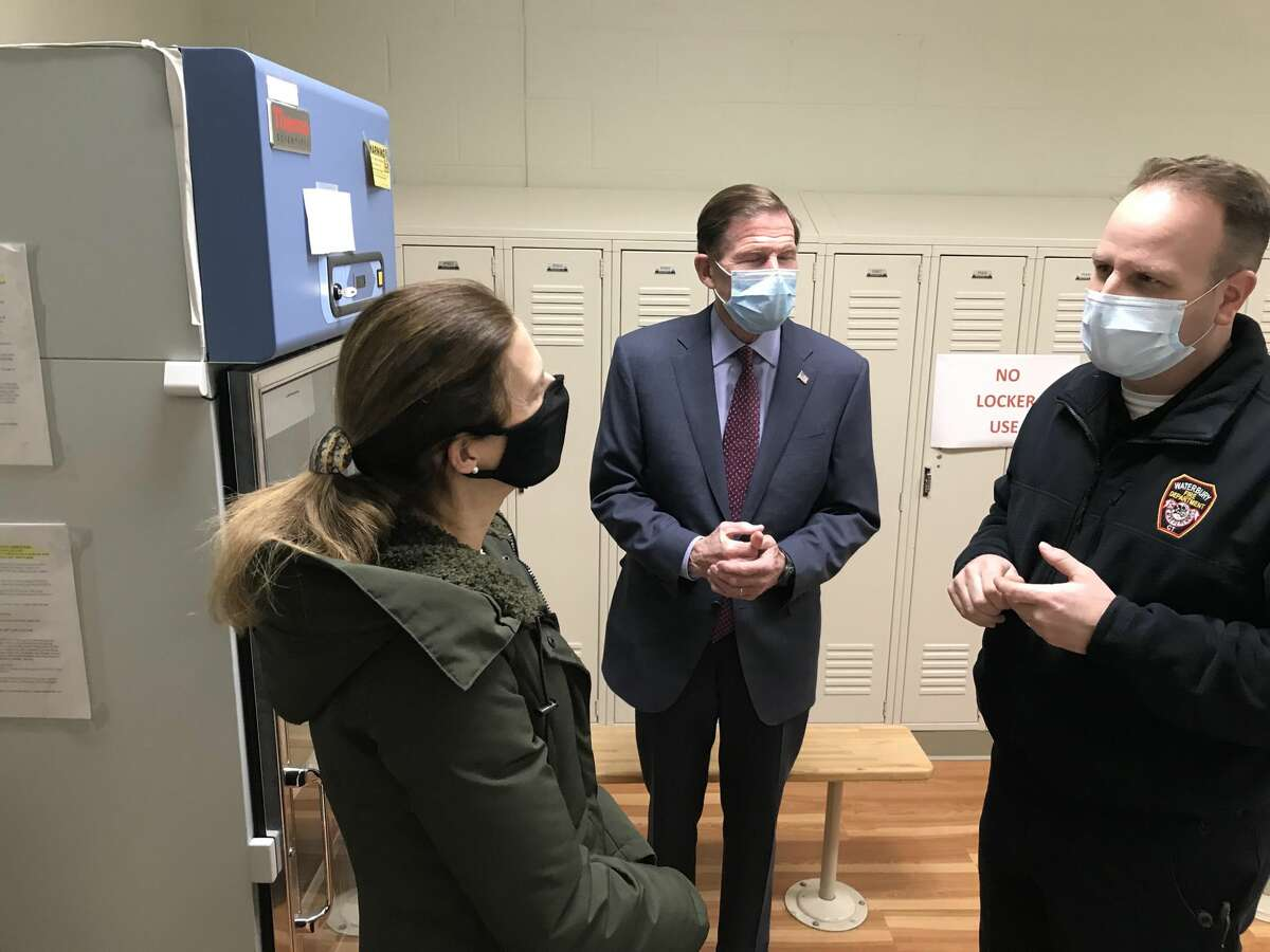 Adam Rinko, right, emergency management director for the city of Waterbury, shows the vaccine storage room to Lt. Gov. Susan Bysiewicz and Sen. Richard Blumenthal on Feb. 19, 2021, at a vaccination clinic at a magnet school run by the city and St. Mary's Hospital.