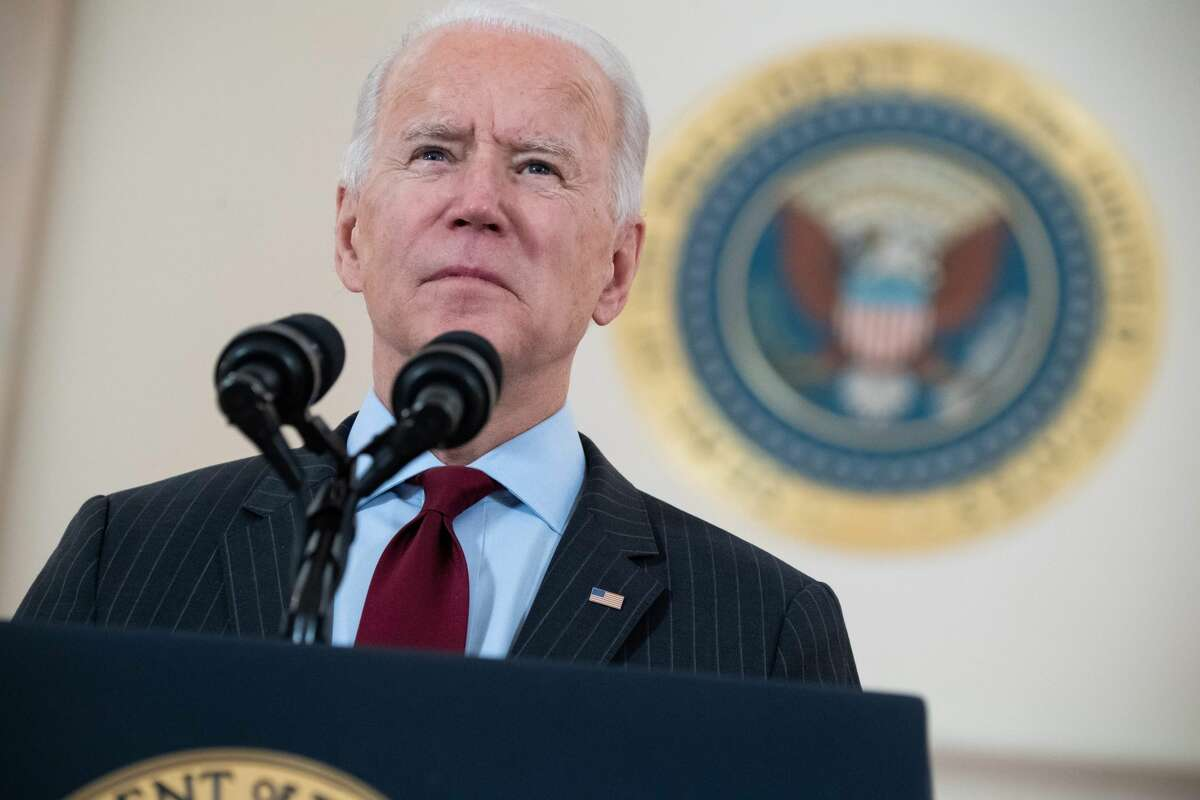 President Joe Biden speaks about lives lost to COVID-19 after the U.S. death toll passed 500,000, in the Cross Hall of the White House in Washington, DC, February 22, 2021.