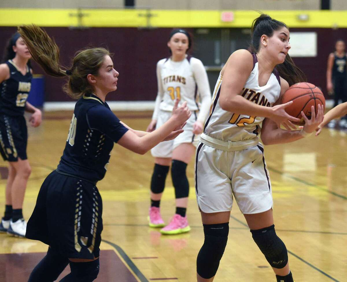 Caitlyn Velez of Sheehan rebounds against Newington in Wallingford on January 20, 2020.