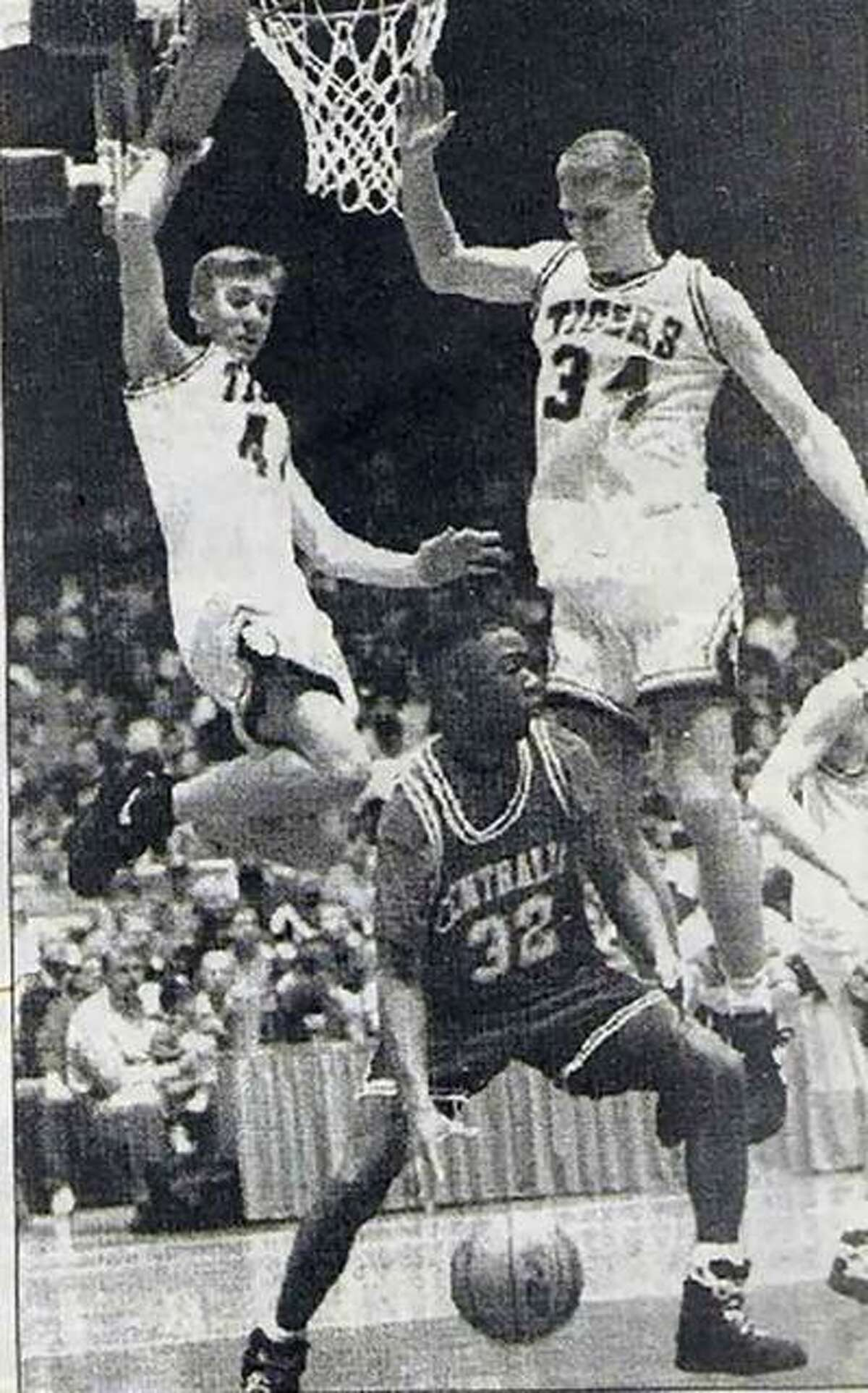 Edwardsville's Justin Range, left, and Andrew Thompson guard Centralia's La Shawn Webster during the Class AA Carbondale Super-Sectional in 1993.