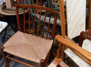A fiber rush chair, left, and a woven splint chair are seen in Marie's Chair Caning and Furniture Repair owned by Bob Gordon on Monday, Feb. 22, 2021 in Ballston Spa, N.Y. (Lori Van Buren/Times Union)