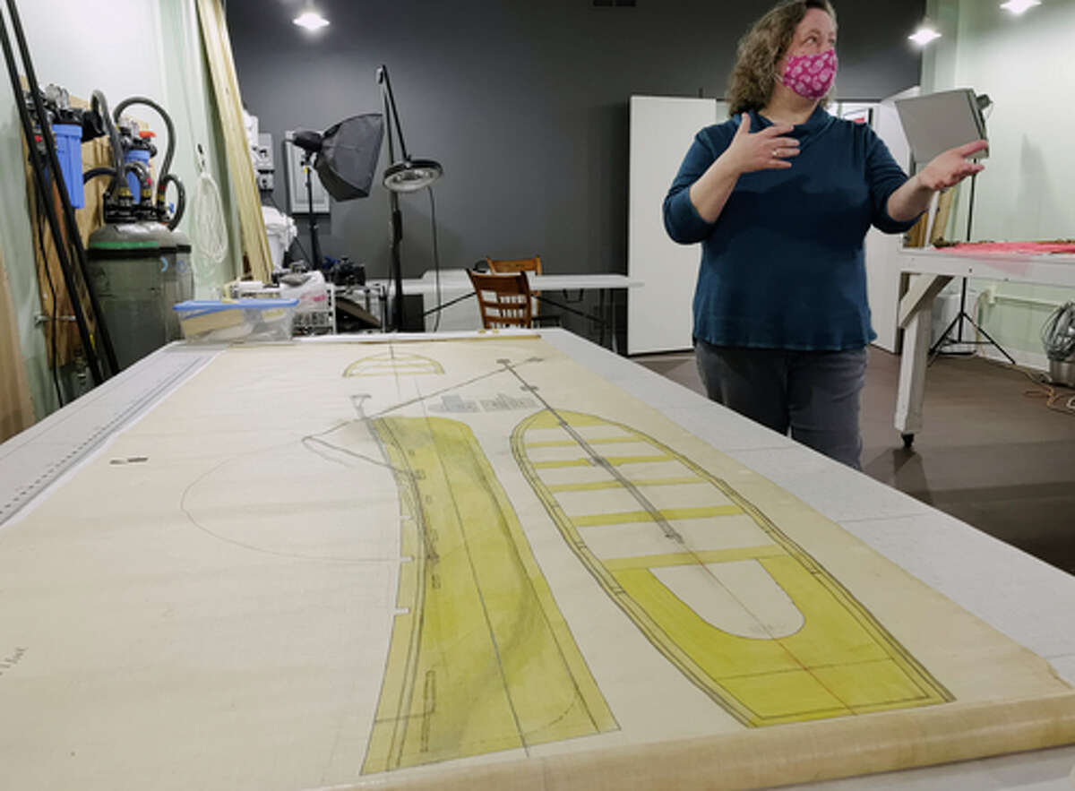 Sarah Stevens, owner of Zephyr Preservation Studio, talks about her work to preserve a torpedo linen on Monday, Feb. 15, 2021, in Cohoes, N.Y. The linen is part of the collection of the Naval War College Museum in Newport, Rhode Island. (Paul Buckowski/Times Union)