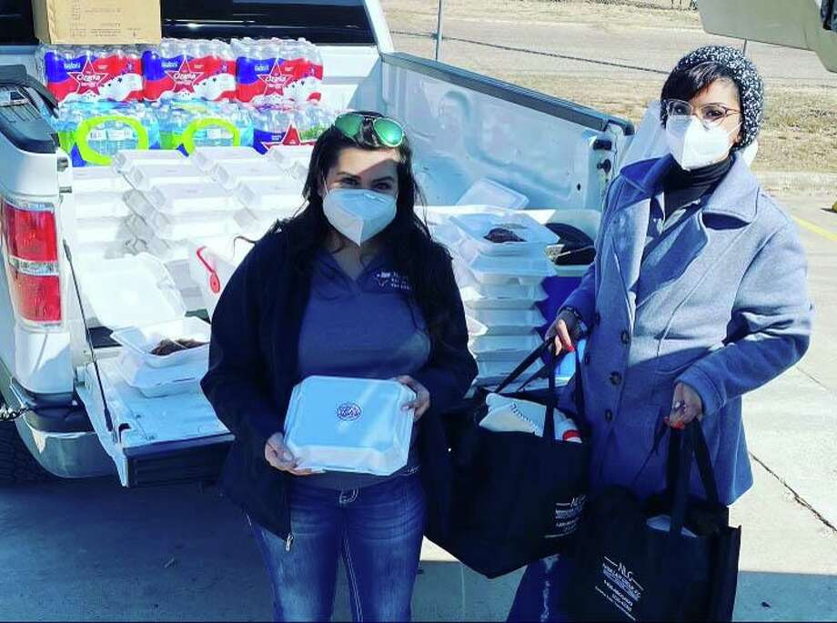 Donations of blankets and meals were provided on Friday by employees and volunteers of the Texans Recovering Together program at the Rio Bravo Community Center Photo: /