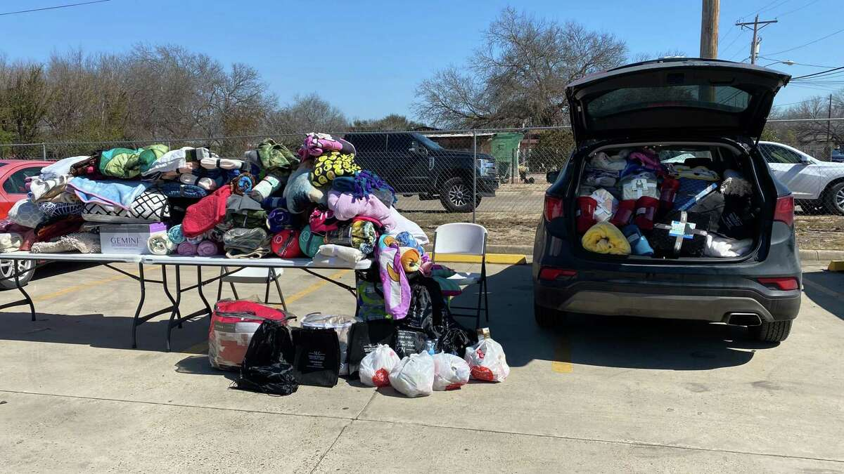 Donations of blankets and meals were provided on Friday by employees and volunteers of the Texans Recovering Together program at the Rio Bravo Community Center