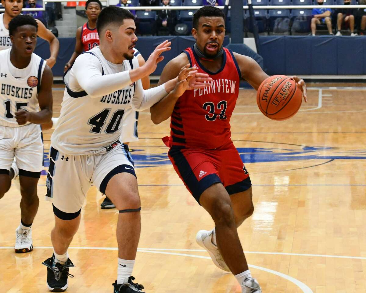 Plainview's Zabrin Duncan dribbles up the court against the Fort Stockton defense.