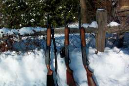 """The Remington Model 870 """"Express"""" shotguns can be configured different waysby simply and easily changing barrels.Pictured, from left, are a12-gauge with a 20-inch smoothbore barrel equipped with iron sights, a 20-gauge with a rifled 18.5-inch barrel equipped with a red-dot sight, and a 28-gauge with a26-inch vent-ribbed barrel. (Tom Lounsbury/Hearst Michigan)"""