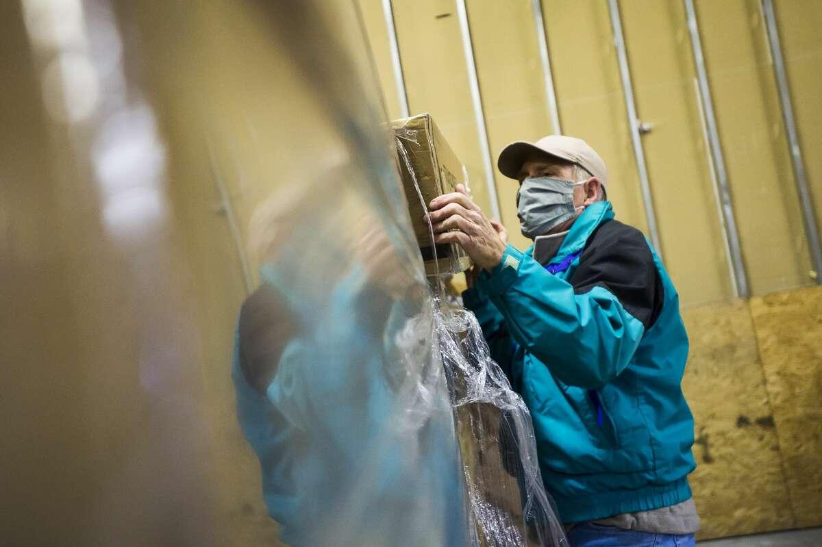 Volunteers begin assembling one of 50