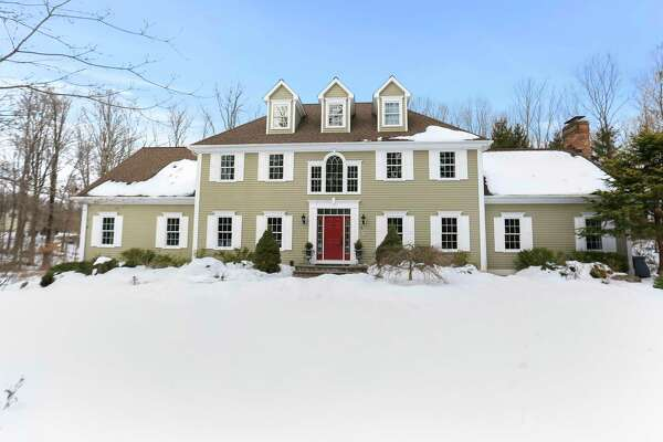 Taupe-colored colonial at 8 Canterbury Lane, Easton.