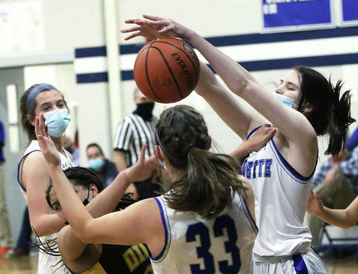 Marquette Catholic's Abby Williams (right), shown blocking an off-balance shot by EA-WR's Emily Johnson in a game Feb. 10 in Alton, scored 15 points in the Explorers' loss Monday night at Freeburg.