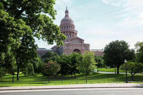The Texas State Capitol building stands in Austin, Texas, U.S., on Thursday, June 2, 2016. Steve Adler, Austin's mayor, thinks he can put his stamp on the city by burnishing its reputation as an exciting playground for experiments in urban transportation. One of his political priorities is to seek millions in federal funding to promote a so-called smart city plan based on autonomous buses, sensors that know which parking spaces are available and, yes, a culture of ridesharing. Photographer: David Williams/Bloomberg