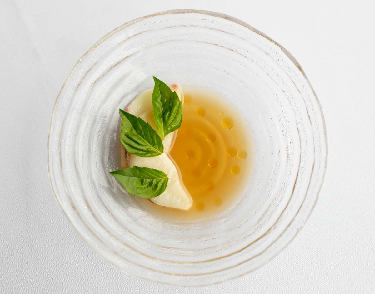 The freshness of raw, thinly sliced hamachi (yellowtail tuna) layered with large basil leaves in a dashi broth absolutely pops against Hakutsauru Junmai Daiginjo-Kobe sake. Goldman: