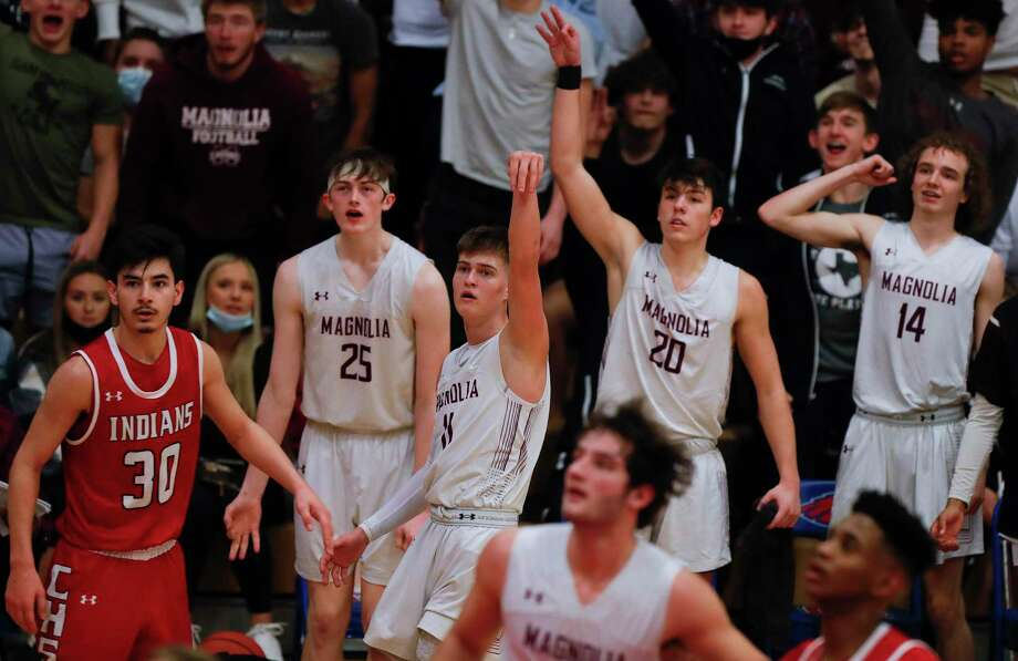 Magnolia shooting guard Connor Lindvall (11) hits a 3-pointer at the buzzer to end the third quarter of a Region III-5A area bi-district basketball playoff game at Oak Ridge High School, Saturday, Feb. 20, 2021. Photo: Jason Fochtman, Houston Chronicle / Staff Photographer / 2021 © Houston Chronicle