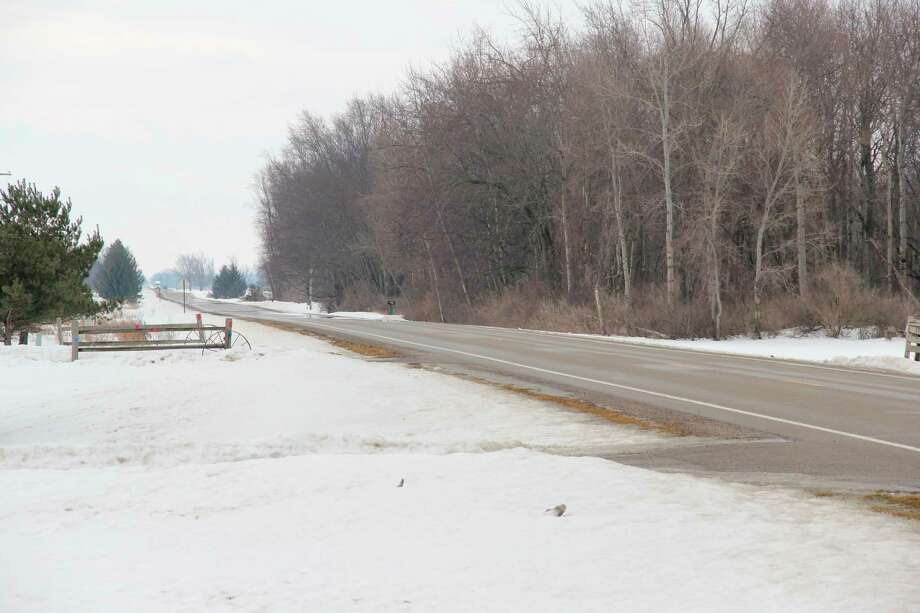 County roads like Bad Axe Road are subject to seasonal weight restrictions starting this weekend. They are meant to protect the asphalt on the roads from further damage from frost. (Robert Creenan/Huron Daily Tribune)