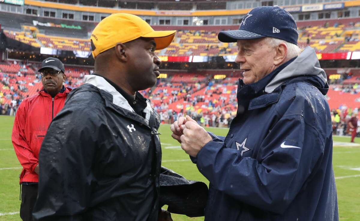 There's no telling what Dallas Cowboys owner Jerry Jones is telling NFL players union chief DeMaurice Smith in this 2017 photo, but hopefully it's not a story about chickens and owls.