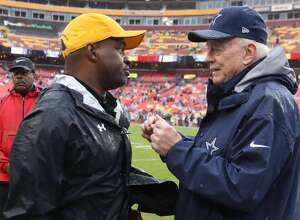 Cowboys owner Jerry Jones meets with Executive Director of the National Football League Players Association DeMaurice Smith prior to the start of the Dallas Cowboys against the Washington Redskins at FedEx Field on October 29, 2017 in Landover, Maryland. (Photo by Rob Carr/Getty Images)
