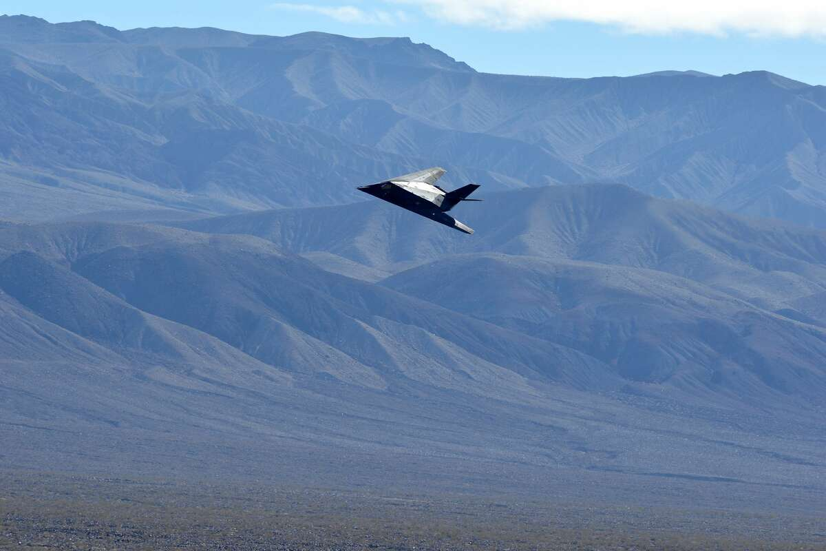 FILE: The F-117 Nighthawk stealth fighter flies on Feb. 27, 2019 in Death Valley, California.