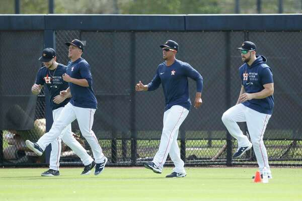 Houston Astros outfielders Kyle Tucker (30), Myles Straw (3), Michael Brantley (23), and Steven Souza Jr. (20) run during the second day of full-squad workouts for the Astros at Ballpark of the Palm Beaches in West Palm Beach, Florida, Tuesday, February 23, 2021.
