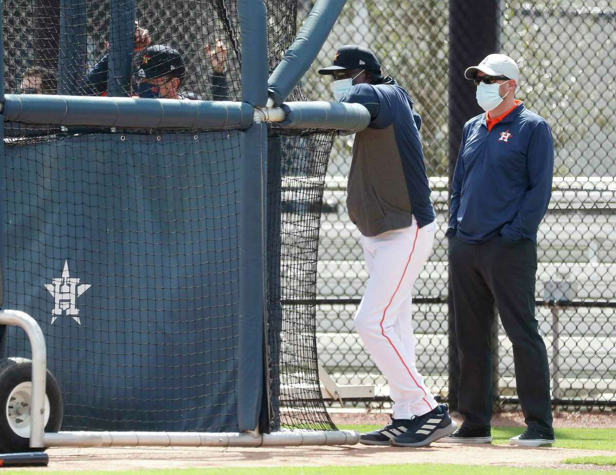 Houston Astros GM James Click and manager Dusty Baker watch Carlos Correa at bat during the second day of full-squad workouts for the Astros at Ballpark of the Palm Beaches in West Palm Beach, Florida, Tuesday, February 23, 2021.