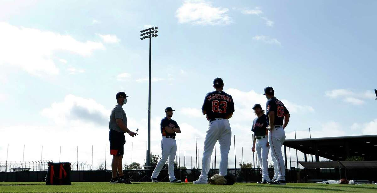 Houston Astros pitchers stand on the field during the second day of full-squad workouts for the Astros at Ballpark of the Palm Beaches in West Palm Beach, Florida, Tuesday, February 23, 2021.