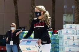 Paige Fertitta, member of the Fertitta family, helps out at a bottled water distributing event Tuesday, Feb. 23, 2021, at Toyota Center in Houston. City of Houston partners with the Rockets to distribute bottled water to people in need.