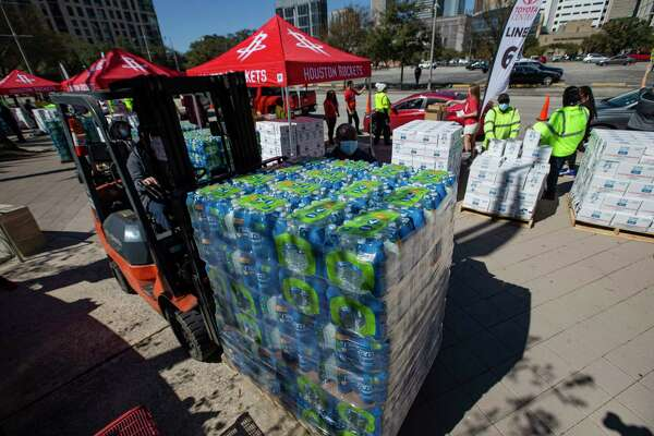 City of Houston partners with Houston Rockets to distribute bottled water to people in need Tuesday, Feb. 23, 2021, at Toyota Center in Houston.