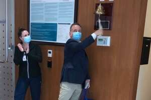 John Coppola of West Haven rings a bell at the conclusion of a round of cancer treatment.