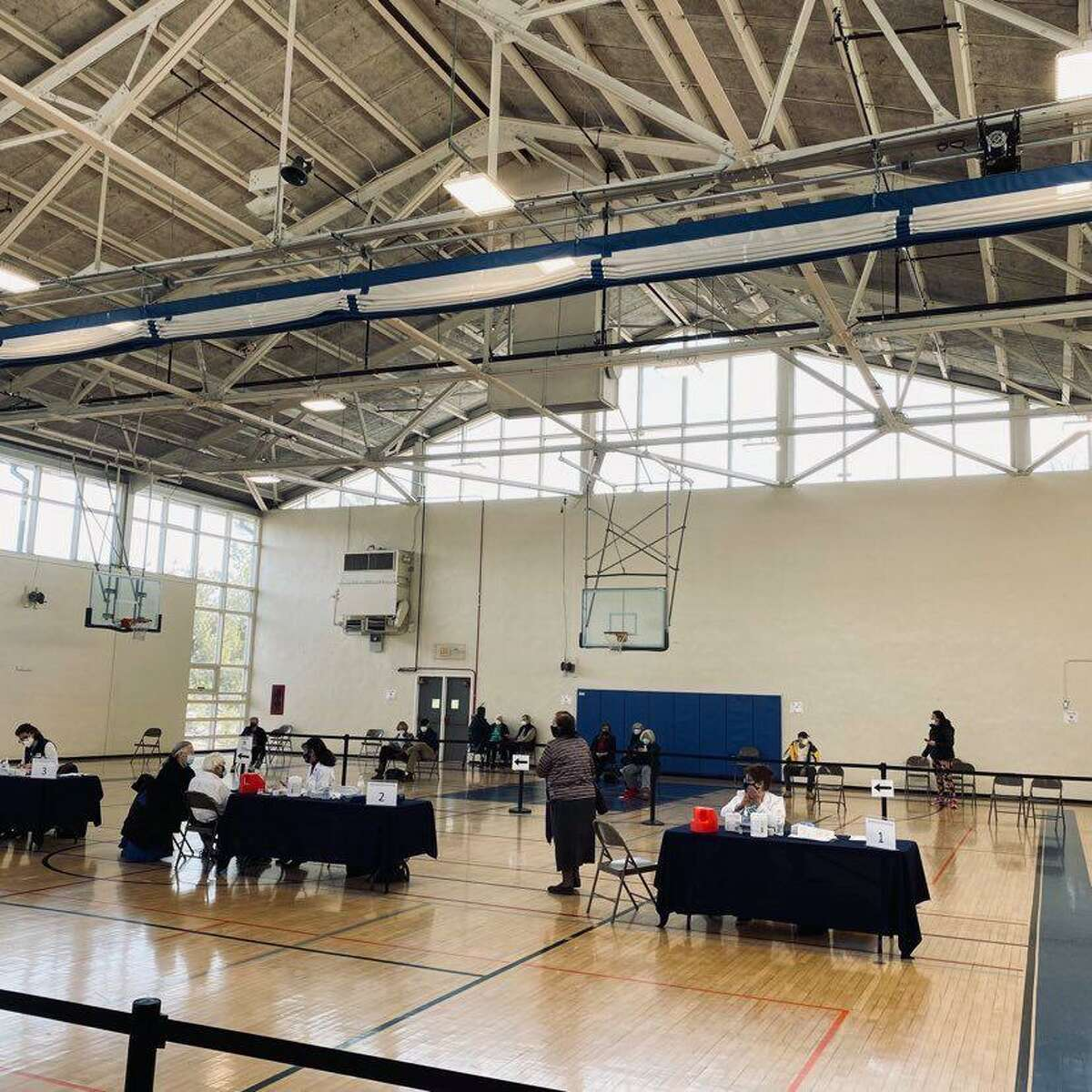 Darien teachers and school employees will begin receiving the vaccine next week at the Mather Community Center gymnasium where the clinic is currently set up.