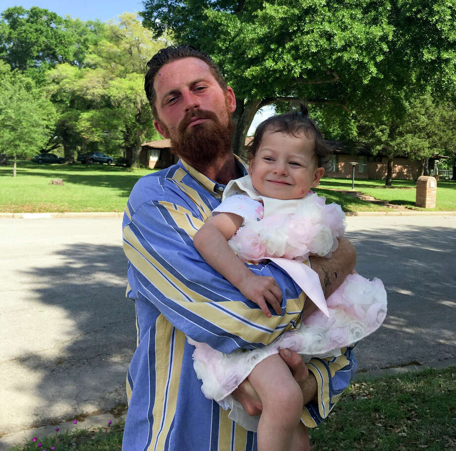 Trevor Cook holds his daughter, Lieah. Lieah was two when her father died after years of failing to receive help for his mental illness. (Courtesy/Cary Cook)