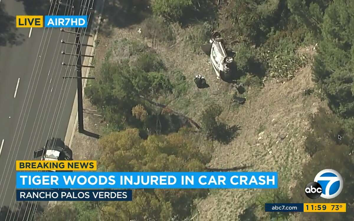 In this aerial image take from video provided by KABC-TV video, a vehicle rest on its side after a rollover accident involving golfer Tiger Woods along a road in the Rancho Palos Verdes section of Los Angeles on Tuesday, Feb. 23, 2021. Woods had to be extricated from the vehicle with the