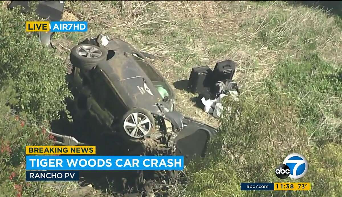 In this an aerial image take from video provided by KABC-TV video, a vehicle rest on it's side after rollover involving golfer Tiger Woods along a road in the Rancho Palos Verdes section of Los Angeles on Tuesday, Feb. 23, 2021. Woods had to be extricated from the vehicle with the