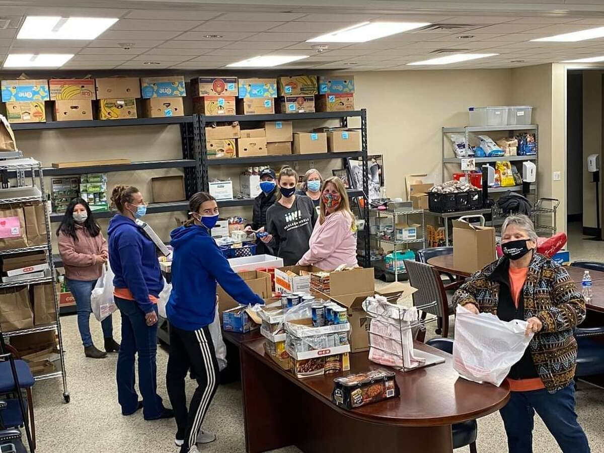 Meals on Wheels Montgomery County volunteers clean out fridges and freezers after a winter storm spoiled $15,000 in food items for senior citizens.