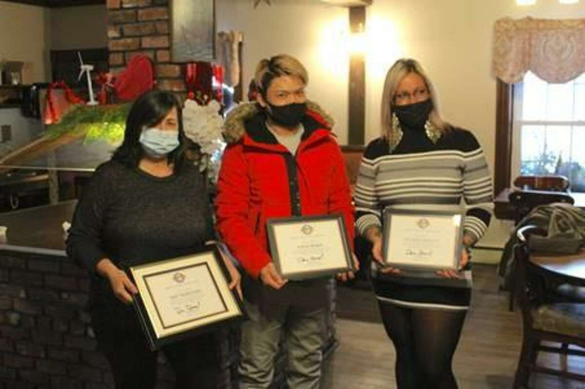 Friends of Main Street recently held a facade poster contest. From left are first place winner Voula Ignadis, The Tributary Restaurant; third place winner Tony Hang, Papa Boba; and second place winner Shana DeVaux, Sacred Beauty Salon.
