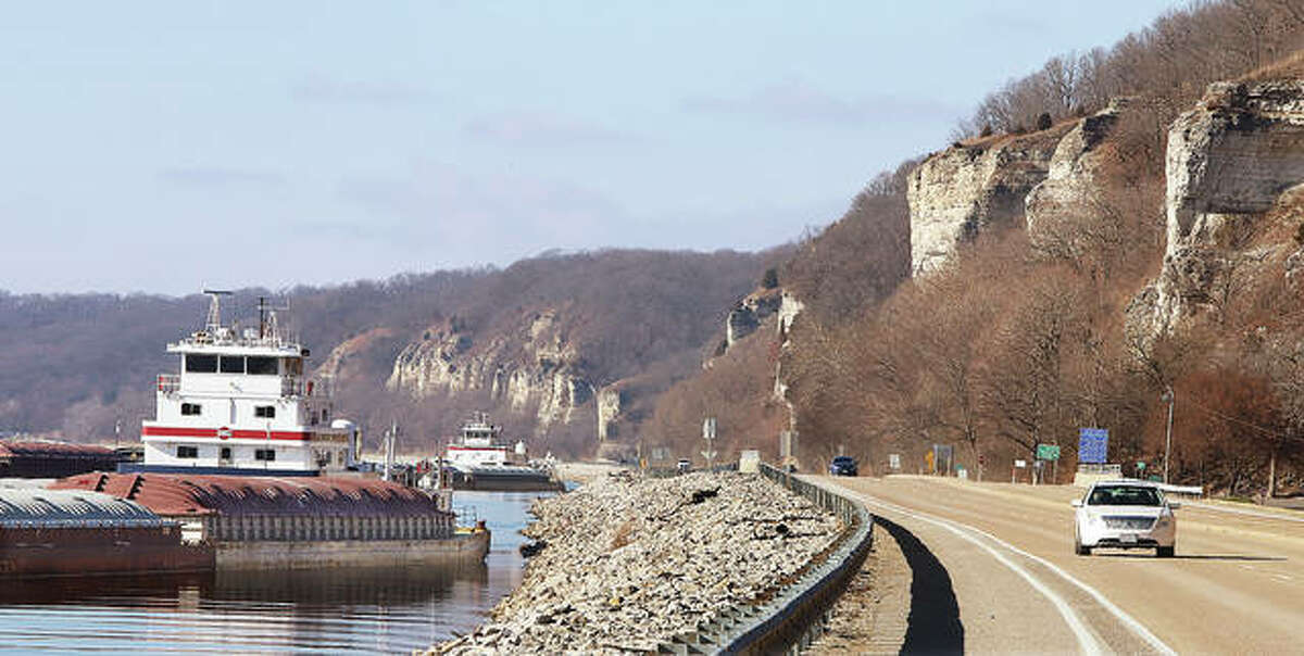 Barges are shown on the Mississippi River in Godfrey in this December photo. Five conservation groups have called for the U.S. Corps of Engineers to conduct a watershed study expected to cost $3 million and take three years for the Upper Mississippi River.
