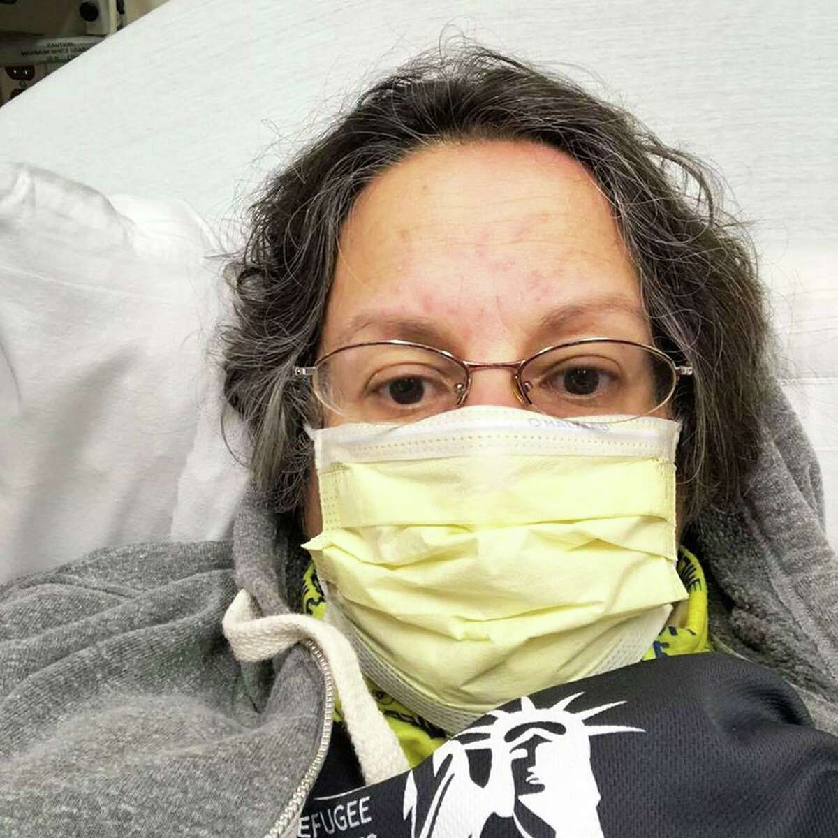 Kathy Flaherty of Newington, executive director of the Connecticut Legal Rights Project in Middletown, is presumptively positive for coronavirus but has gone through a long saga of not getting tested. Her husband, James Valentino, now has symptoms. Both were tested April 1.